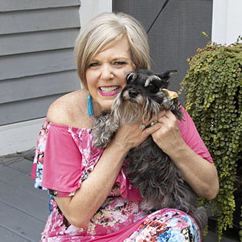 Jennifer Attisano holds her dog