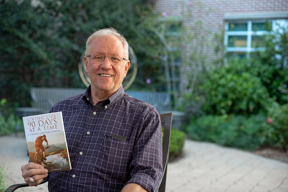 Thom Schmenk with book