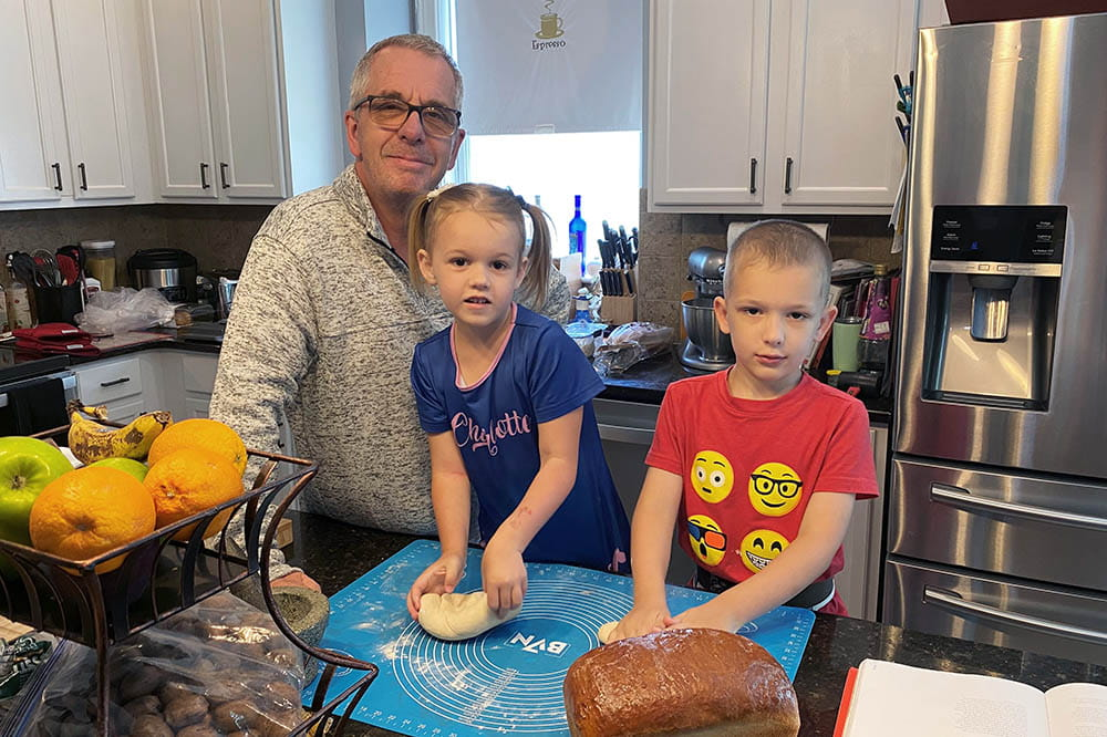 David Turner and his kids baking bread in their kitchen