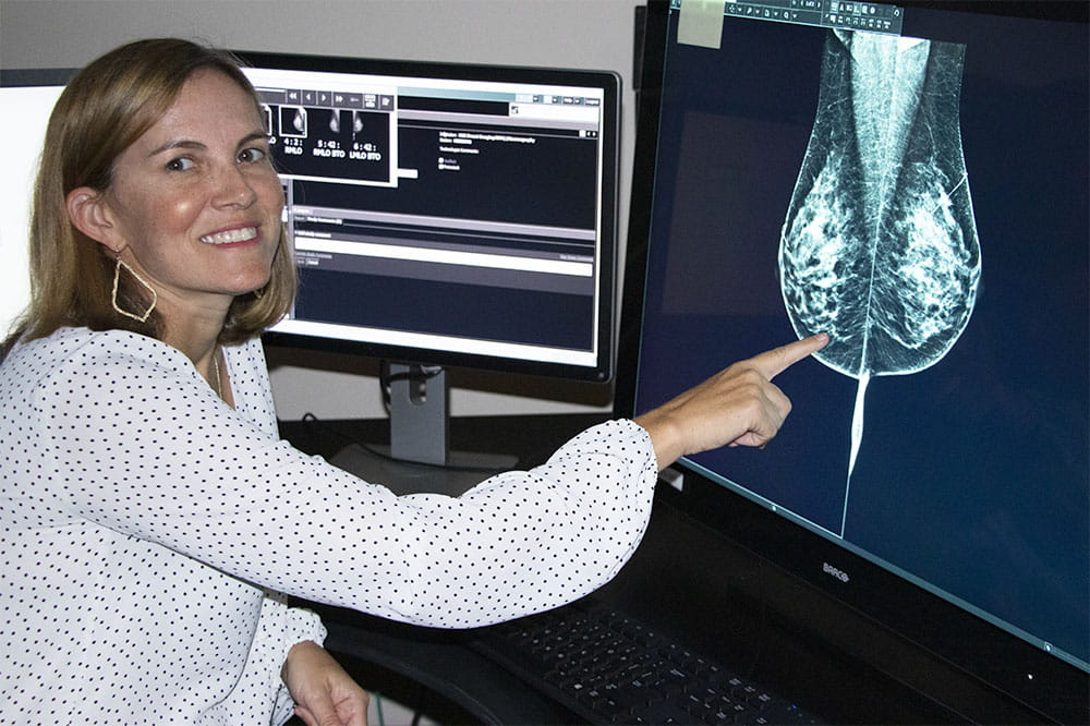Dr. Rebecca Leddy points to a mammogram image on a computer screen