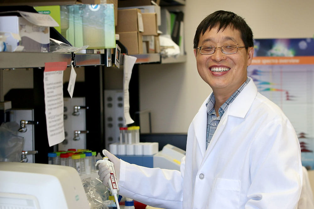 Dr. Xue-Zhong Yu works in his lab
