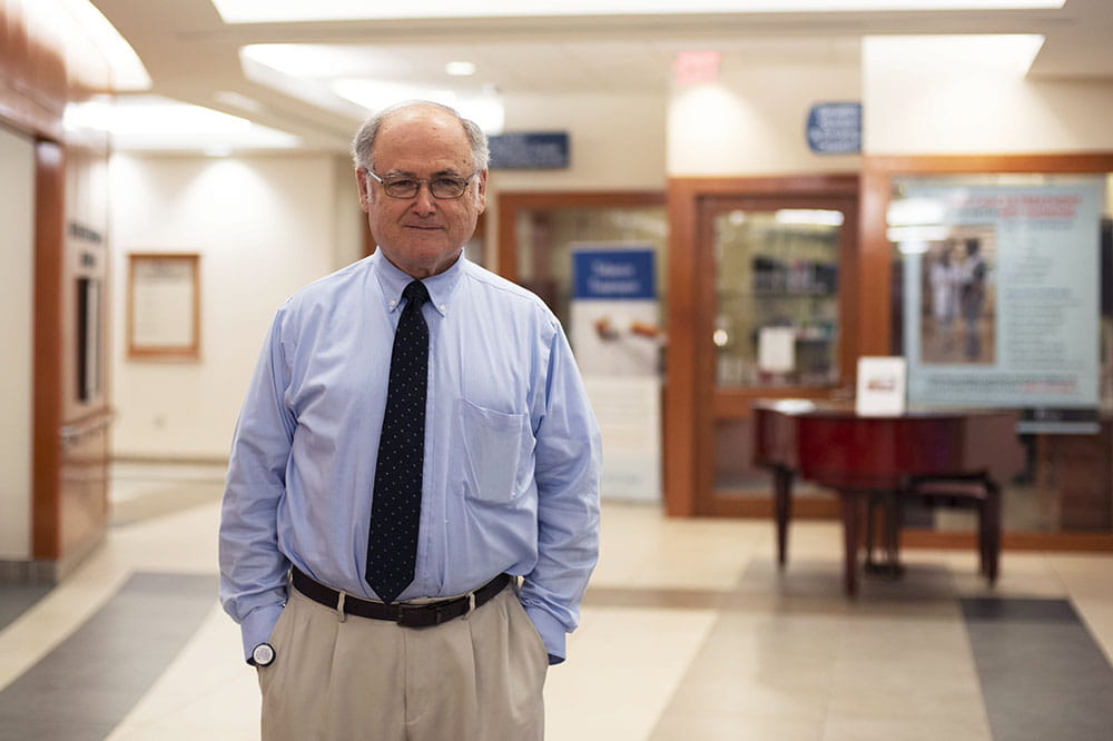 Dr. Michael Lilly stands in the lobby of Hollings Cancer Center