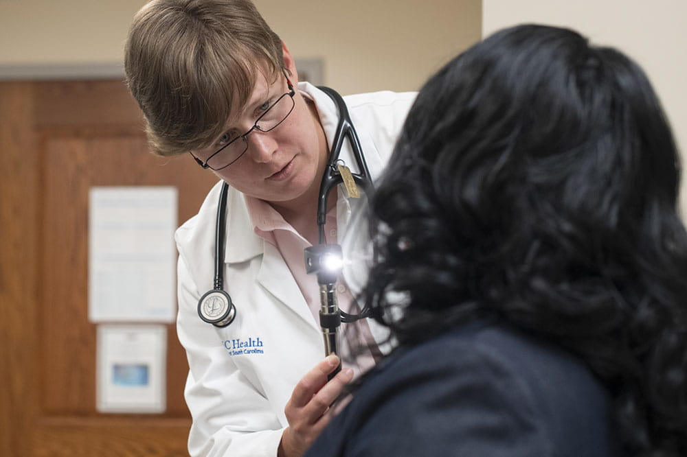Dr. Sarah Tucker Price examines a patient