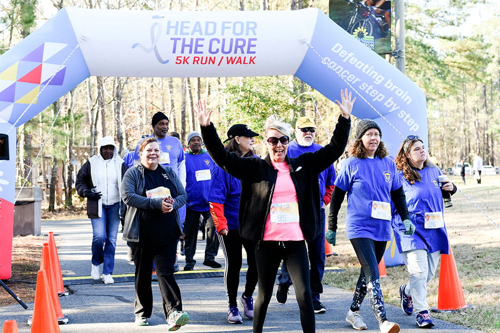 group of participants walk in the head for the cure event in 2020