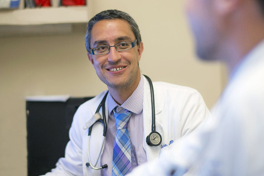 Dr. David Cachia talks with another doctor