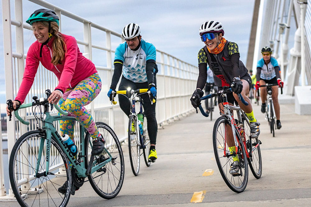 Group of cyclists riding on the Ravenel Bridge in Charleston during Lowvelo 2019